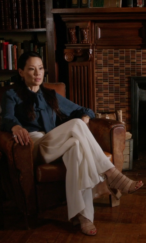 Lucy Liu with See By Chloe Star Perforated Sandals in Elementary