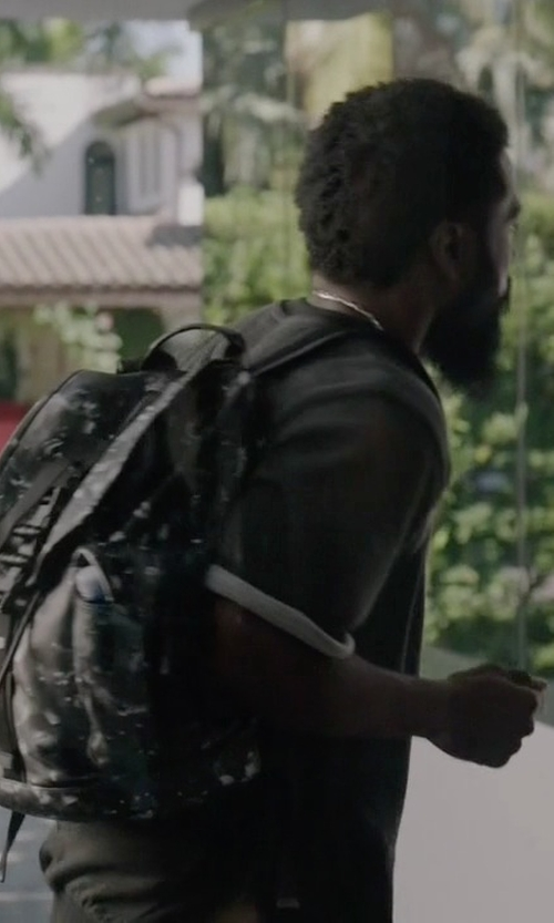 John David Washington with Givenchy Camo Flower-Print Leather Backpack in Ballers