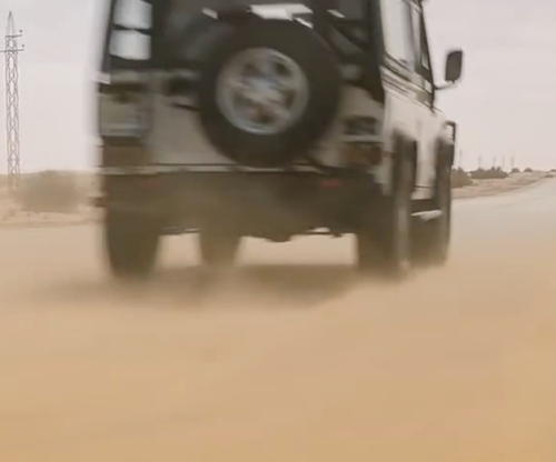 Tom Cruise with Land Rover 1994 Defender 90 SUV in Mission: Impossible - Ghost Protocol