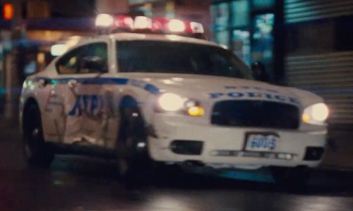 Joel Kinnaman with Dodge 2007 Charger Police Car in Run All Night