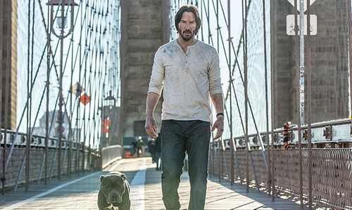 Keanu Reeves with Brooklyn Bridge New York City, New York in John Wick: Chapter 2