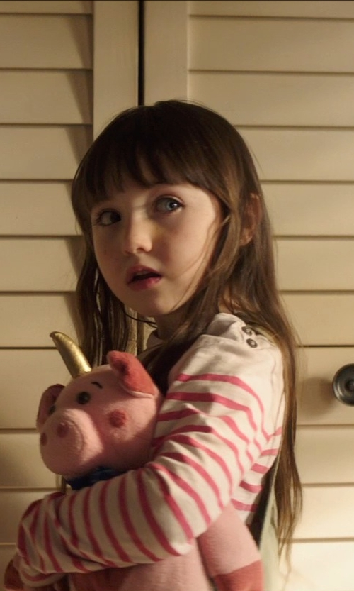 Kennedi Clements with Melissa & Doug Plush Becky Pig Toy in Poltergeist
