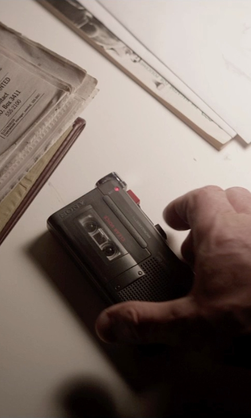 Liam Neeson with Sony M-450 Microcassette Recorder in A Walk Among The Tombstones