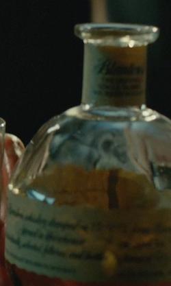 Keanu Reeves with Blanton's The Original Single Barrel Bourbon Whiskey in John Wick