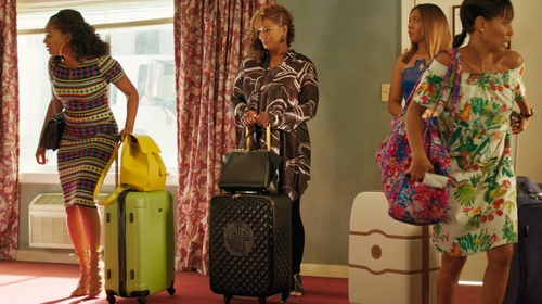 Queen Latifah with Liz Claiborne Quilted Spinner Luggage in Girls Trip
