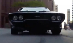 Vin Diesel with Plymouth 1972 GTX Modified Road Runner Coupe in The Fate of the Furious
