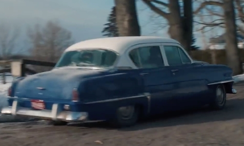 Dane DeHaan with Chevrolet 1955 Bel Air Coupe Car in Life