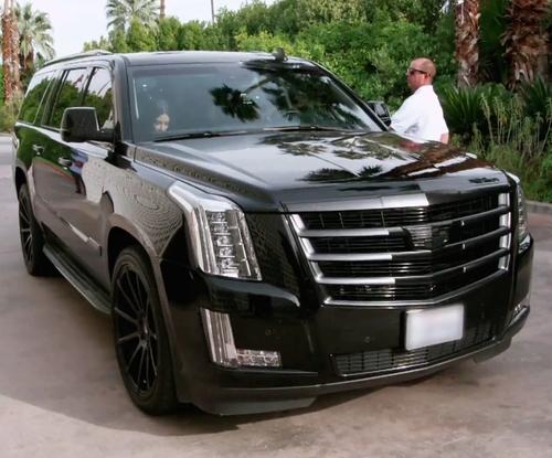 Kourtney Kardashian with Cadillac Escalade SUV in Keeping Up With The Kardashians