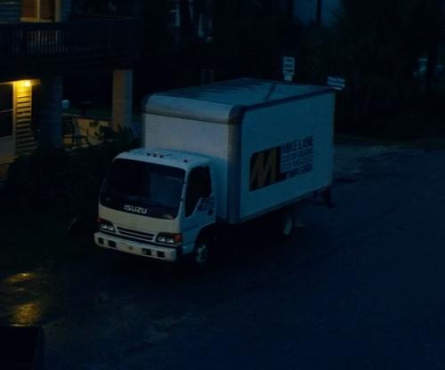 Unknown Actor with Isuzu 2015 NPR HD Box Truck in Magic Mike XXL