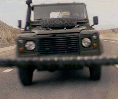Unknown Actor with Land Rover Defender 90 SUV in Fast & Furious 6