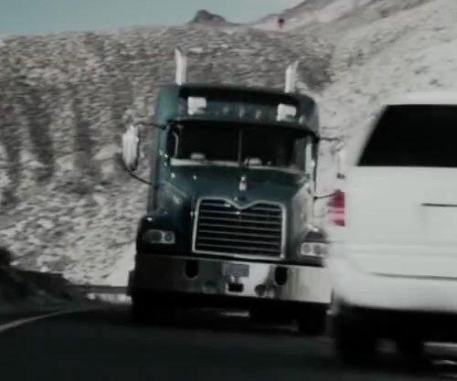 Unknown Actor with Mack Pinnacle Series Truck in The Boy Next Door