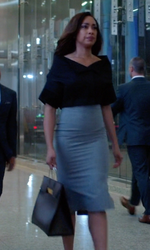 Gina Torres with Balenciaga Cable-Handle Flap Medium Shopper Bag in Suits