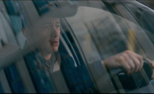 Joseph Gordon-Levitt with Ford 2000 Crown Victoria in The Dark Knight Rises
