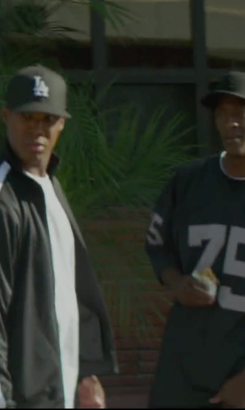 Aldis Hodge with Jerseys To You Los Angeles Raiders 1987 Dark Howie Long 75 Black Jersey in Straight Outta Compton