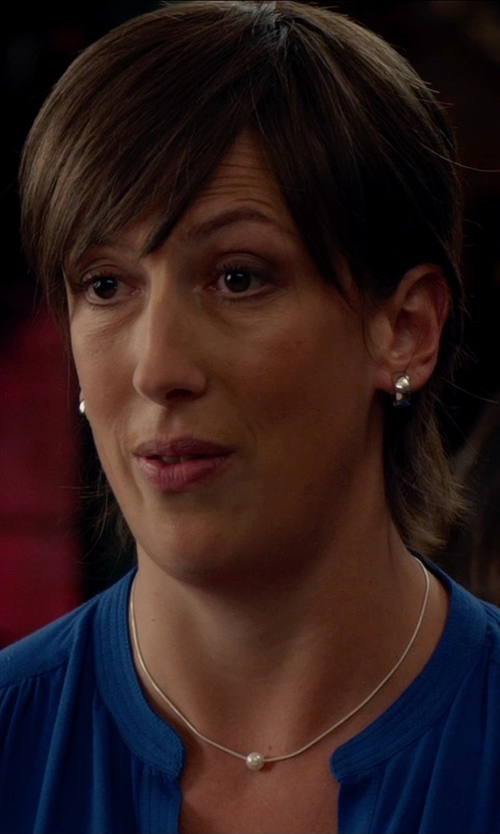 Miranda Hart with The Black Bow White Gold Huggie Hoop Earrings in Spy