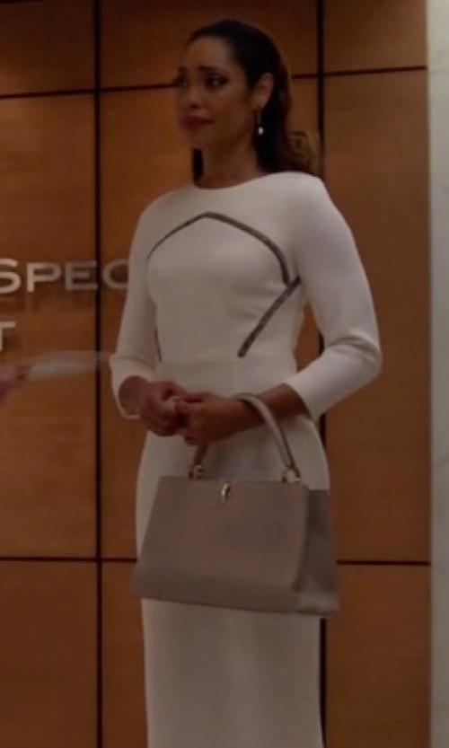 Gina Torres with Louis Vuitton Parnassea Capucines Handbag in Suits