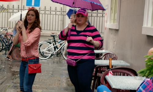 Rebel Wilson with Ralph Lauren Pink and Navy Horizontal Striped Knit Shirt in Pitch Perfect 2