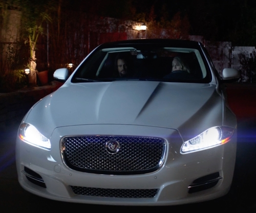 Ellen Barkin with Jaguar XJL Sedan in Animal Kingdom