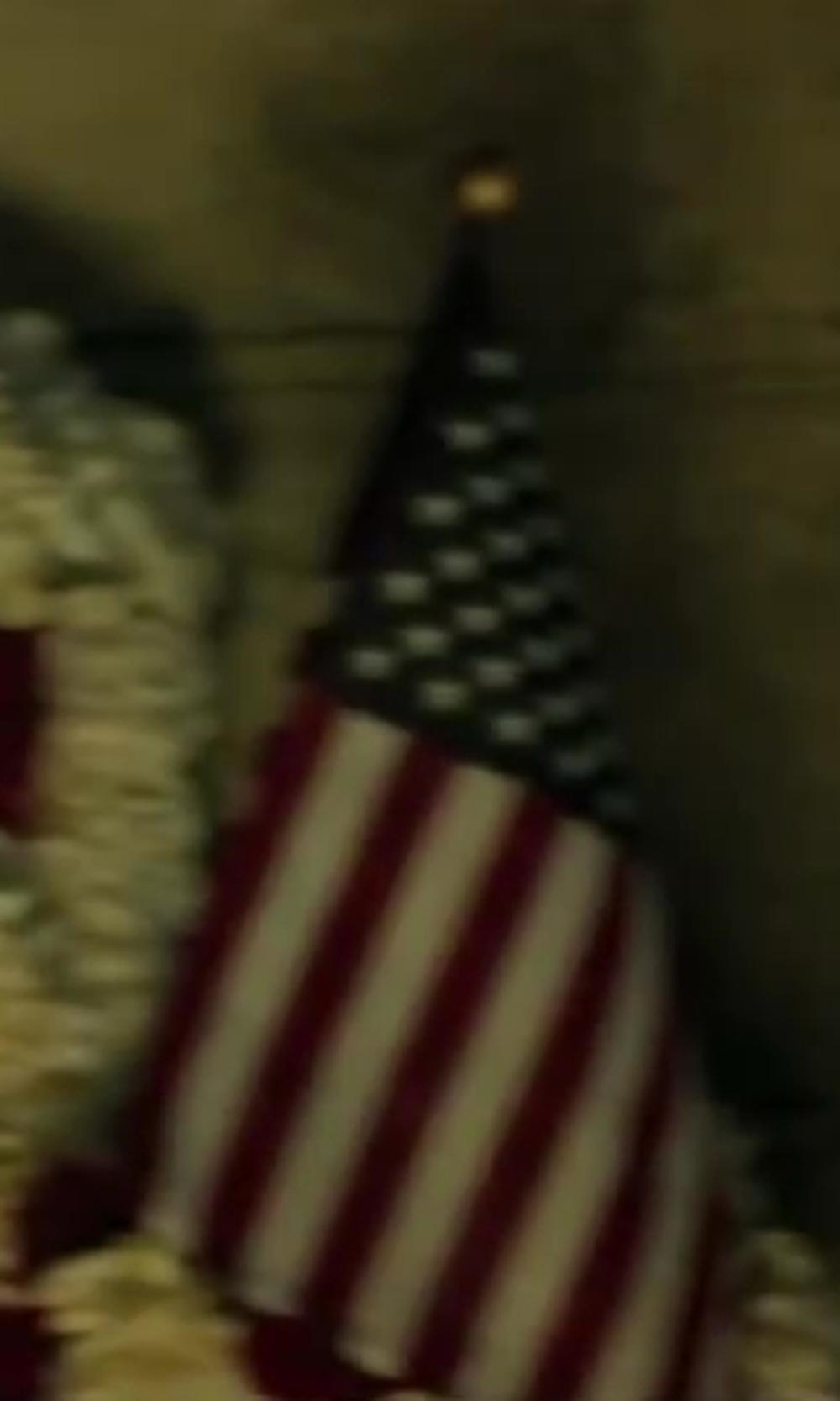 Unknown Actor with Flag and banner US MINIATURE FLAG in Iron Man 3