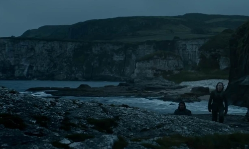 Unknown Actor with Murlough Bay (Depicted as The Iron Islands) Ballycastle, County Antrim in Game of Thrones