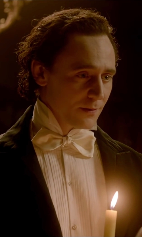 Tom Hiddleston with The Tie Bar Solid Satin Slim Self-Tie Bow Tie in Crimson Peak
