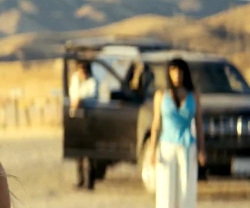 Salma Hayek with Lincoln Navigator in Savages