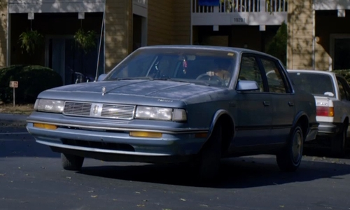 Kate Mara with Lincoln 1991 Continental Sedan in Captive