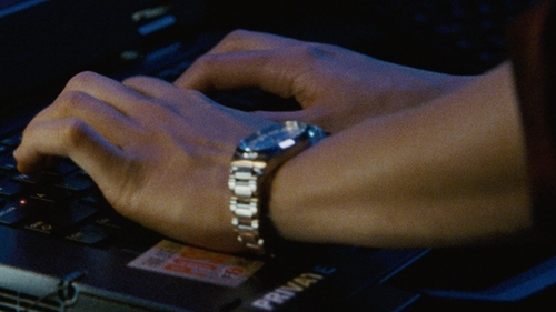 Julia Stiles with Michael Kors Hartman Round Bracelet Watch in Jason Bourne