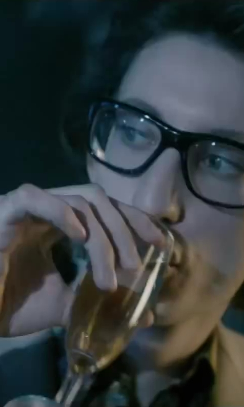 Pierre Niney with Stephanie Champagne Flute Glass in Yves Saint Laurent