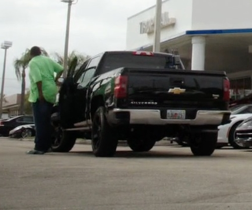 Omar Benson Miller with Chevrolet 2014 Silverado Pickup Truck in Ballers