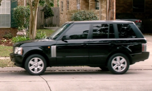 Michael Shannon with Land Rover Range Rover SUV in 99 Homes