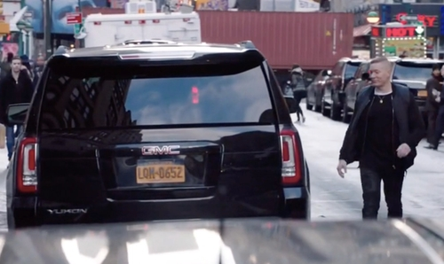 Joseph Sikora with GMC Yukon SUV in Power