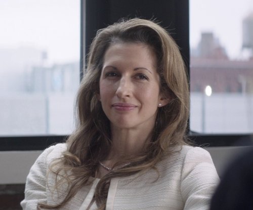 Alysia Reiner with Kwiat Diamond & Platinum Stud Earrings in That Awkward Moment