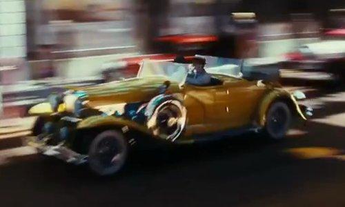 Leonardo DiCaprio with Duesenberg 1929 SJ Lebaron Dual Cowl Phaeton Vintage Sport Car in The Great Gatsby