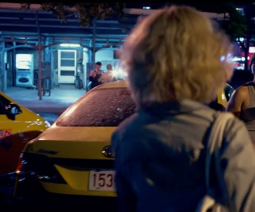 Unknown Actor with Toyota Camry in Lucy