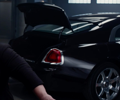 Unknown Actor with Rolls-Royce Wraith Coupé Car in Spy