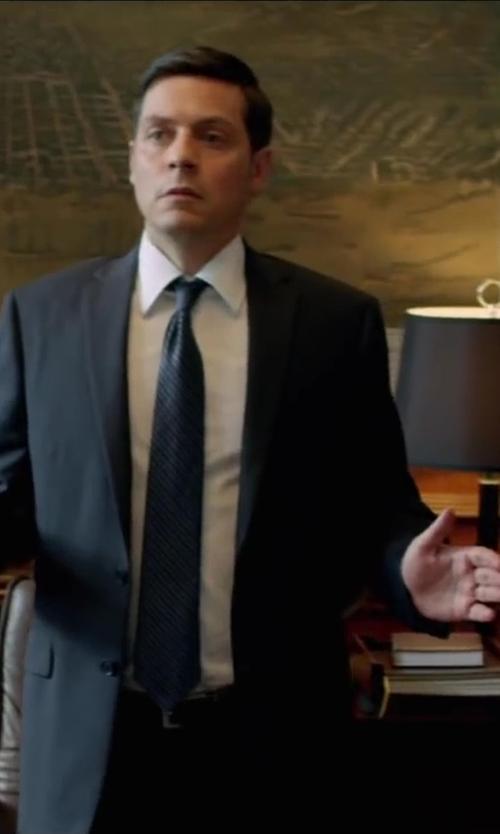 Bruce Ramsay with Calvin Klein tie silk regimen Tal stripe in Brick Mansions