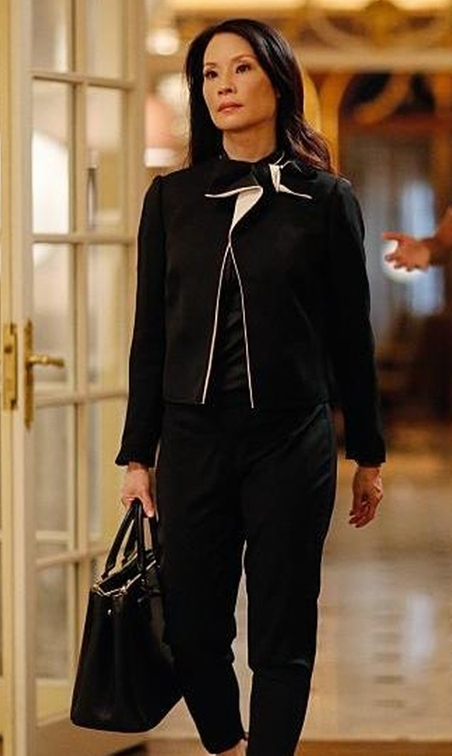 Lucy Liu with Tory Burch Britten Tote Bag in Elementary