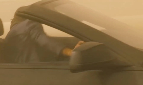 Tom Cruise with BMW 2011 6 Series Convertible in Mission: Impossible - Ghost Protocol