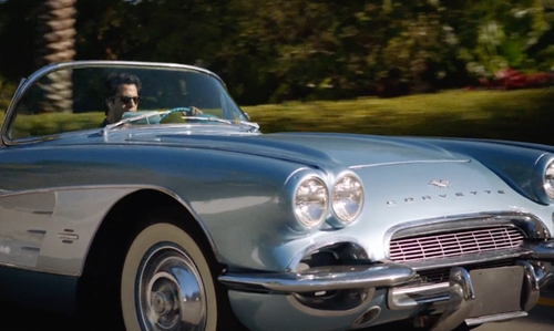 Troy Garity with Chevrolet 1961 Corvette Convertible Car in Ballers