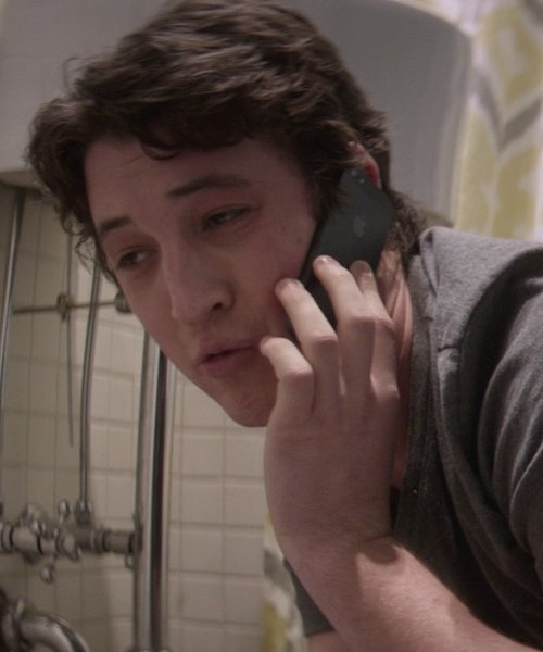 Miles Teller with Apple iPhone 5s in That Awkward Moment