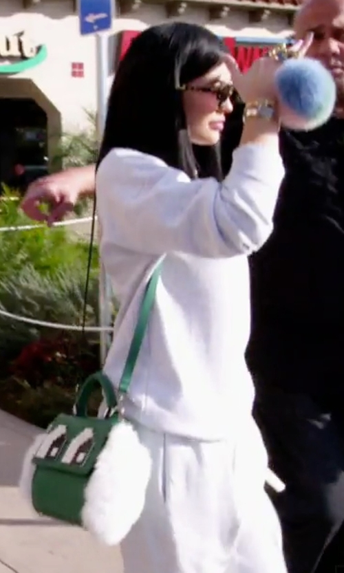 Kylie Jenner with Les Petits Joueurs Mini Alex Eyes Fur Purse in Keeping Up With The Kardashians