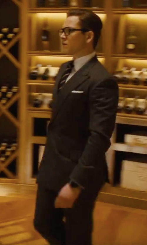 Taron Egerton with Kingsman Eggsy's Charcoal Double-Breasted Chalk-Striped Wool Suit Jacket in Kingsman: The Golden Circle
