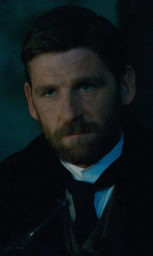 Paul Anderson with Title Of Work Feather Charm Neck Tie in Sherlock Holmes: A Game of Shadows