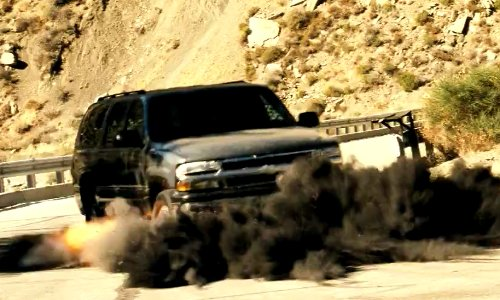 Unknown Actor with Chevrolet Suburban in Savages