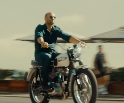 Jason Statham with Triumph 1966 T120TT Bonneville Motorbike in Mechanic: Resurrection