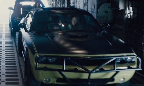 Michelle Rodriguez with Dodge 2011 Challenger SRT8 Coupe in Furious 7