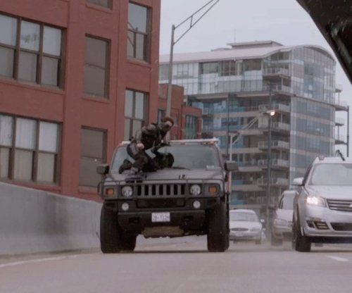 Unknown Actor with Hummer H2 in Captain America: The Winter Soldier
