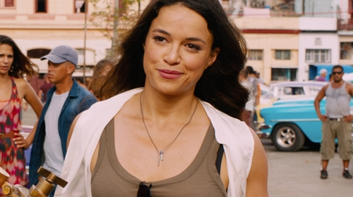 Michelle Rodriguez with Vince Cropped Slide Slit Shell Shirt in The Fate of the Furious