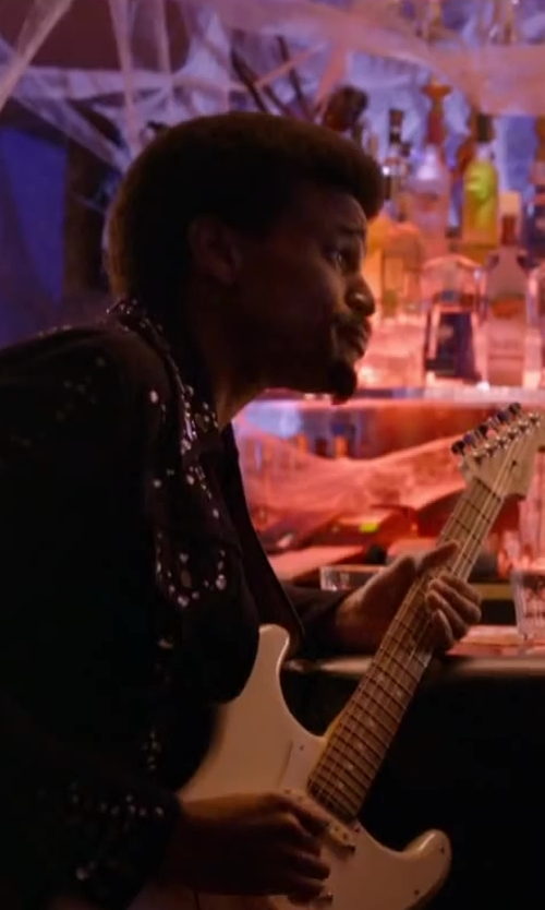 Michael Ealy with FENDER The Eric Johnson signature Stratocaster guitar in About Last Night